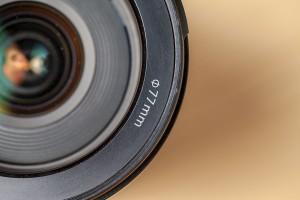 digital single lens reflex camera objective on blurry background